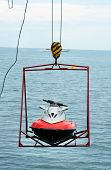 stock photo of ski-doo  - jet ski lift for dry storage on the sea background - JPG