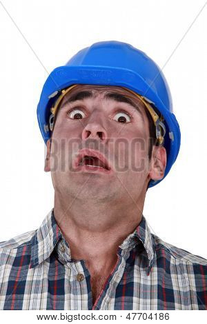 Horrified manual worker