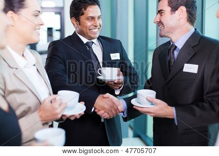friendly business people interacting during conference break