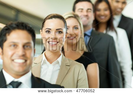 successful business people in a row looking at the camera