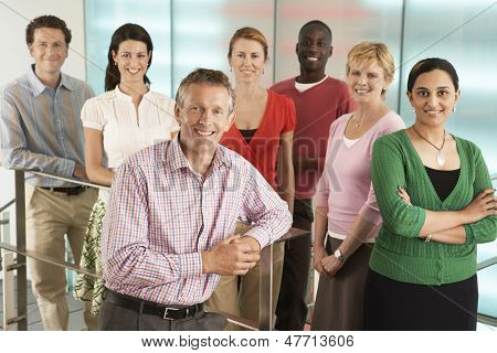 Group portrait of multiethnic business people smiling in office