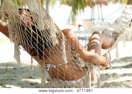 Woman Sleeping On Hammock