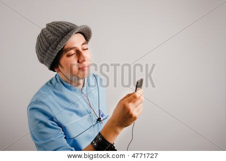 Stylish Young Man Listening To Music