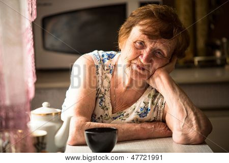 An elderly woman at his home