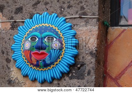 Colorful artistic blue sun on a San Miguel de Allende wall