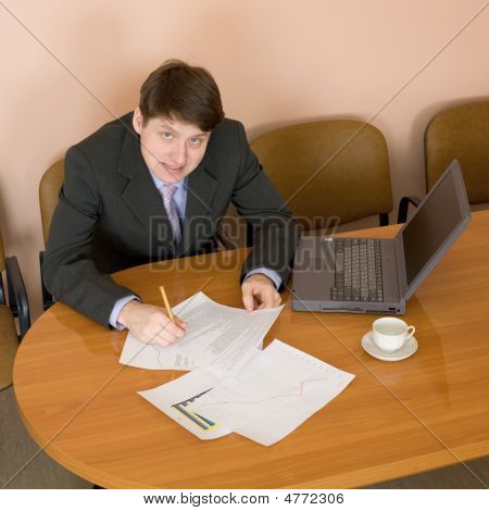 Businessman On A Workplace With The Laptop