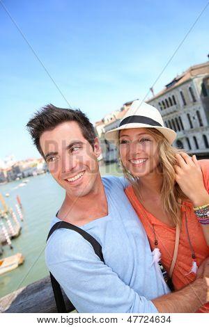 Couple standing on the Academia Bridge in Venice, Italy