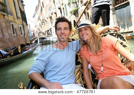 Couple in Venice having a Gondola ride on the canal