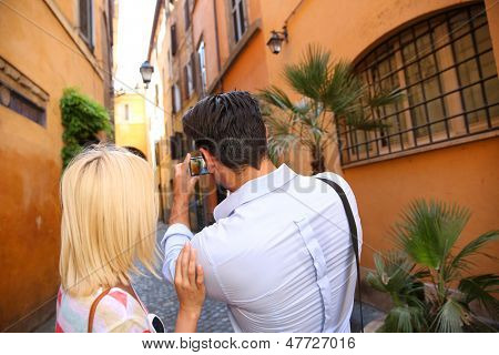 Couple of tourists taking picture in the streets of Rome
