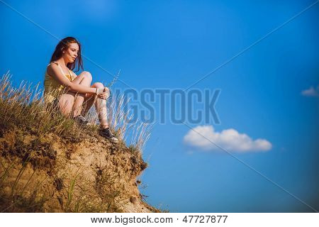 acrophobia punk, hippie woman suicide tall stands on top of a ro