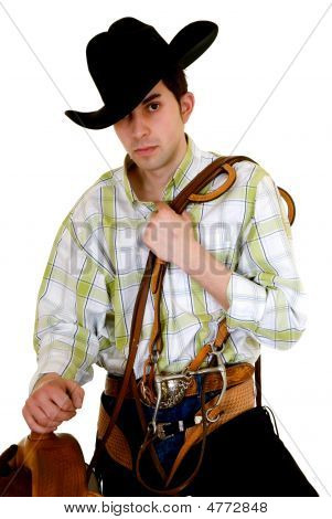 Cowboy With Saddle And Rein