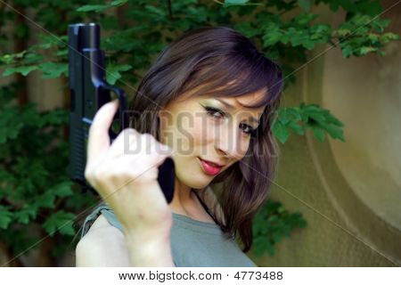 Sexy Smile With A Gun