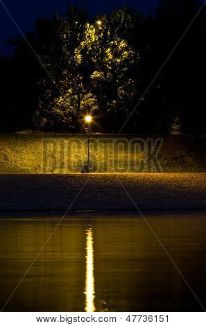 Lantern by the river at night, view from Ada island, Belgrade