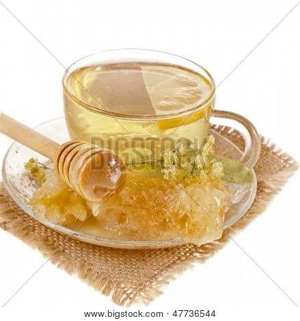 tea cup with linden honey isolated on white background