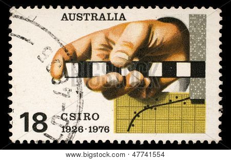 AUSTRALIA - CIRCA 1976: A Stamp printed in AUSTRALIA shows the Survey Rule, Graph, Punched Tape, Commonwealth Scientific and Industrial Research Organization, 50th anniversary, circa 1976