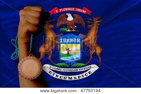 Bronze Medal For Sport And  Flag Of American State Of Michigan