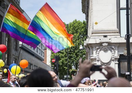 LONDON, UK - JUNE 29: Participants at the gay pride posing for pictures in their balloons outfit, in Baker Street. The yearly parade started in 1972.  June 29, 2013 in London.