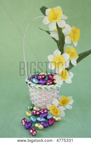 Easter Egg Basket Decorated With Flower On Green