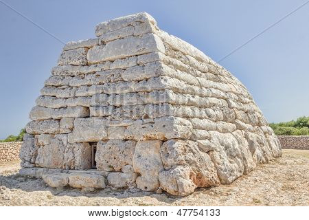 Naveta des Tudons - ancient megalithic chamber tomb at Menorca island; Spain. It served as collective ossuary between 1200 and 750 BC and represet one of the oldest ancient structures in Europe.