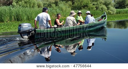 Tourists in a boat visiting the Danube delta