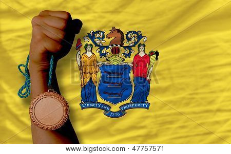 Bronze Medal For Sport And  Flag Of American State Of New Jersey