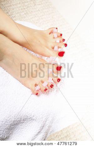 Foot Pedicure Applying Red Toenails