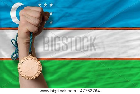 Bronze Medal For Sport And  National Flag Of Uzbekistan