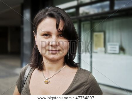 Portrait of an adult woman in the street. Real people series