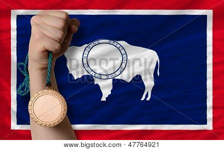 Bronze Medal For Sport And  Flag Of American State Of Wyoming