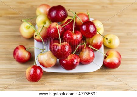Yellow And Red Cherries In White Plate