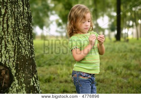Little Toddler Girl Playing On The Park