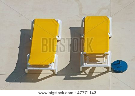two yellow deckchairs, chairs for top lounger