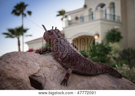 Metal Lizard Stands Guard Over Palatial Home