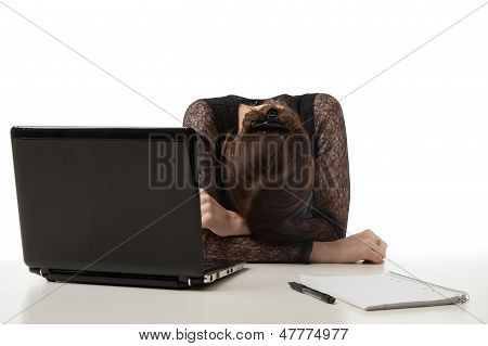 Stressed Businesswoman With Her Head Down