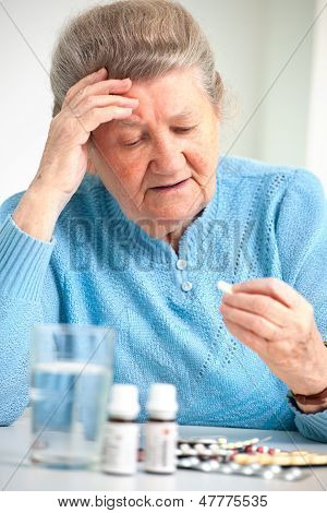 Senior Woman Taking Her Medicine