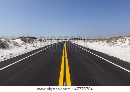 White sand beach road at Gulf Island National Seashore near Pensacola, Florida.