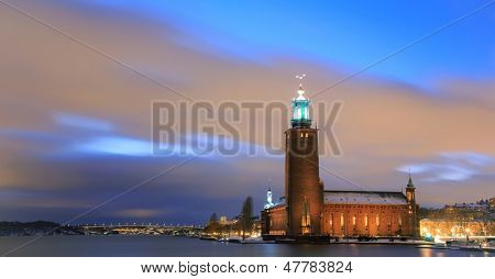 Panorama Stockholm Cityhall at dusk with transportation light trail Sweden