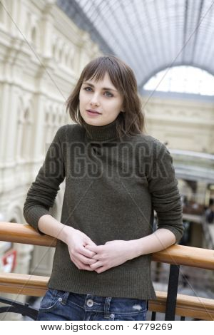 Young Attractive Woman Standing At Railing In State Department Store. Moscow