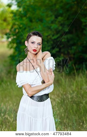 Portrait Of A Girl In A White Dress On The Nature