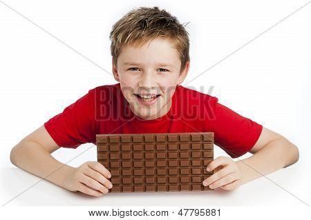 Boy Eating Huge Chocolate Bar
