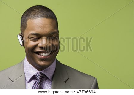 Portrait of businessman with bluetooth headset