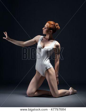 Image of skinny young ballerina posing in studio