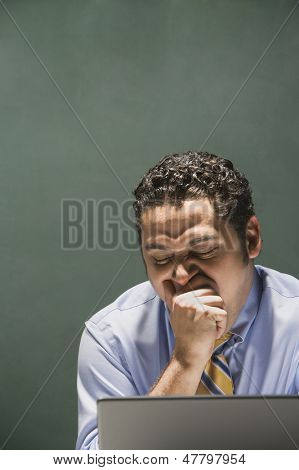 Portrait of businessman yawning