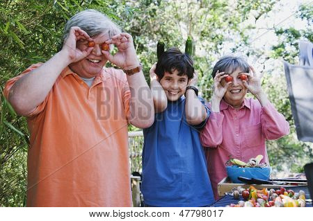 Family playing with food in the garden
