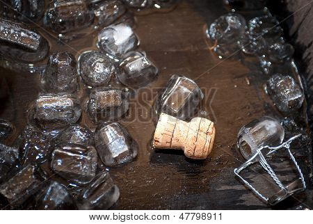 Cork Of Champagne Bottle In Oak Barrel With Ice Cubes