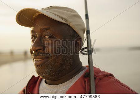 Portrait of man holding fishing pole