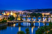 picture of old bridge  - Night view over the Vltava river and bridges in Prague at sunset - JPG