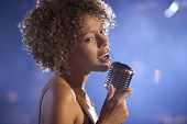pic of singer  - Closeup of a female jazz singer on stage - JPG