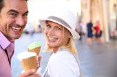 stock photo of cone  - Cheerful couple in Rome eating ice cream cones - JPG