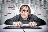 image of virus scan  - Funny hacker in action on his keyboard - JPG